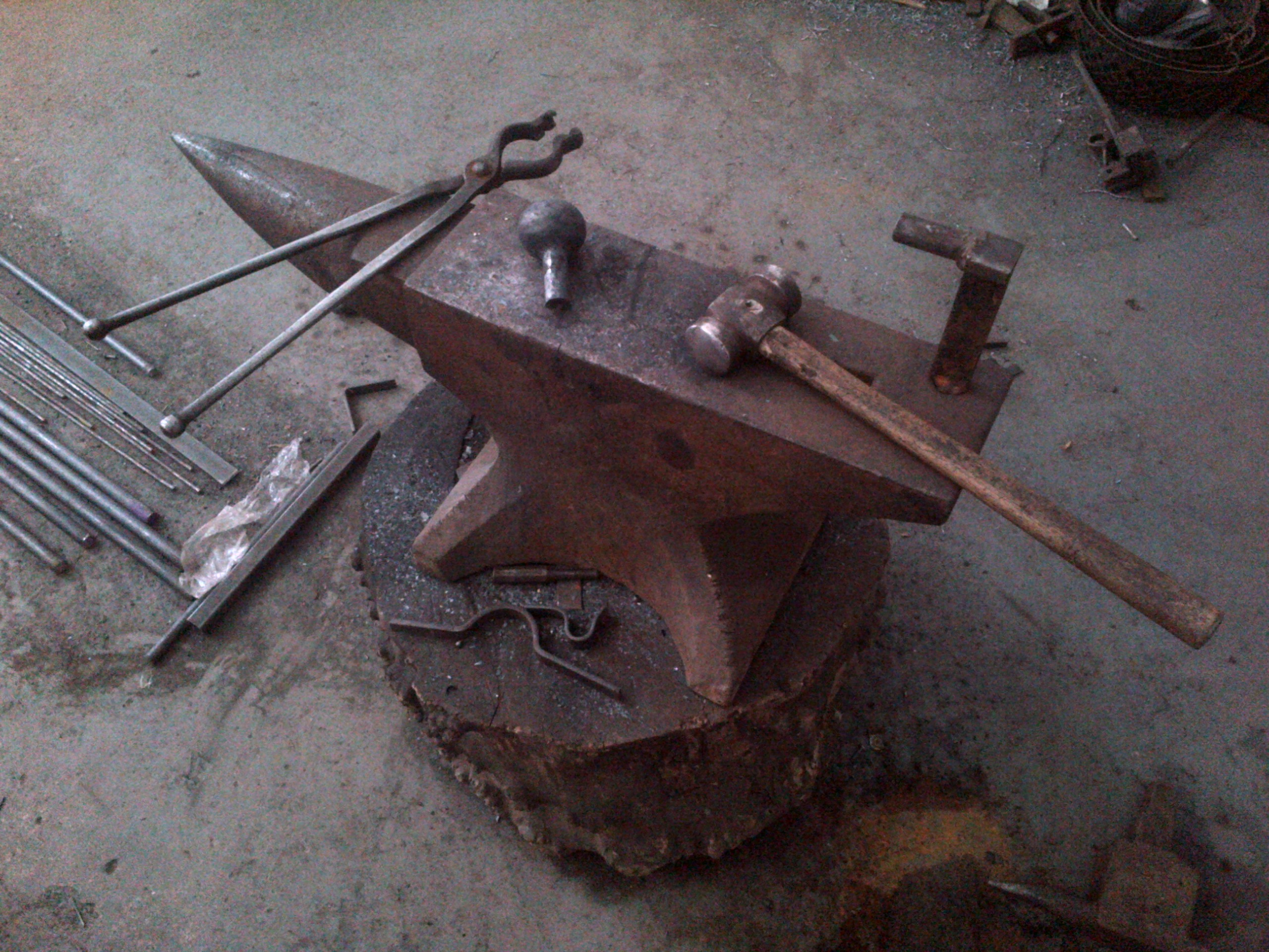 Anvil, tools and a finial in the making