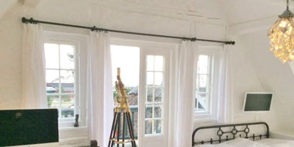Curtain pole above French windows