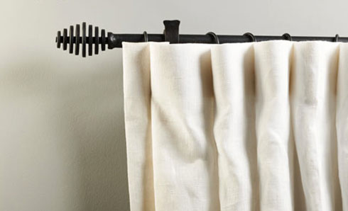 Complete with linen curtain, matt black pole creating a strong contrast on a neutral pale grey wall.