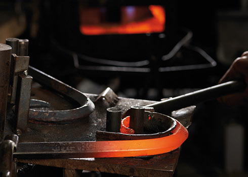 Ram's horn being shaped at the forge to achieve the perfect curve.