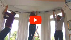 How to install a bay window curtain rod
