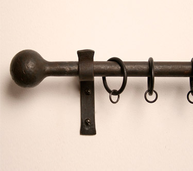 Cannonball finial in wrought iron