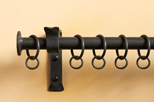 Button finial on wrought iron rail matt black finish