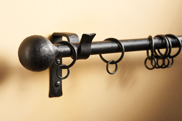 Curtain pole with cannonball finial with matt black finish